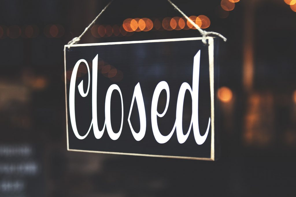 Closed sign hanging in window